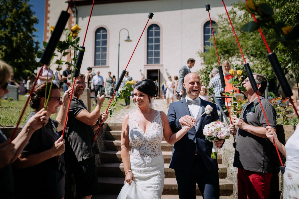 Empfang,Brautpaar,frisch verheiratet,Rosenspalier,