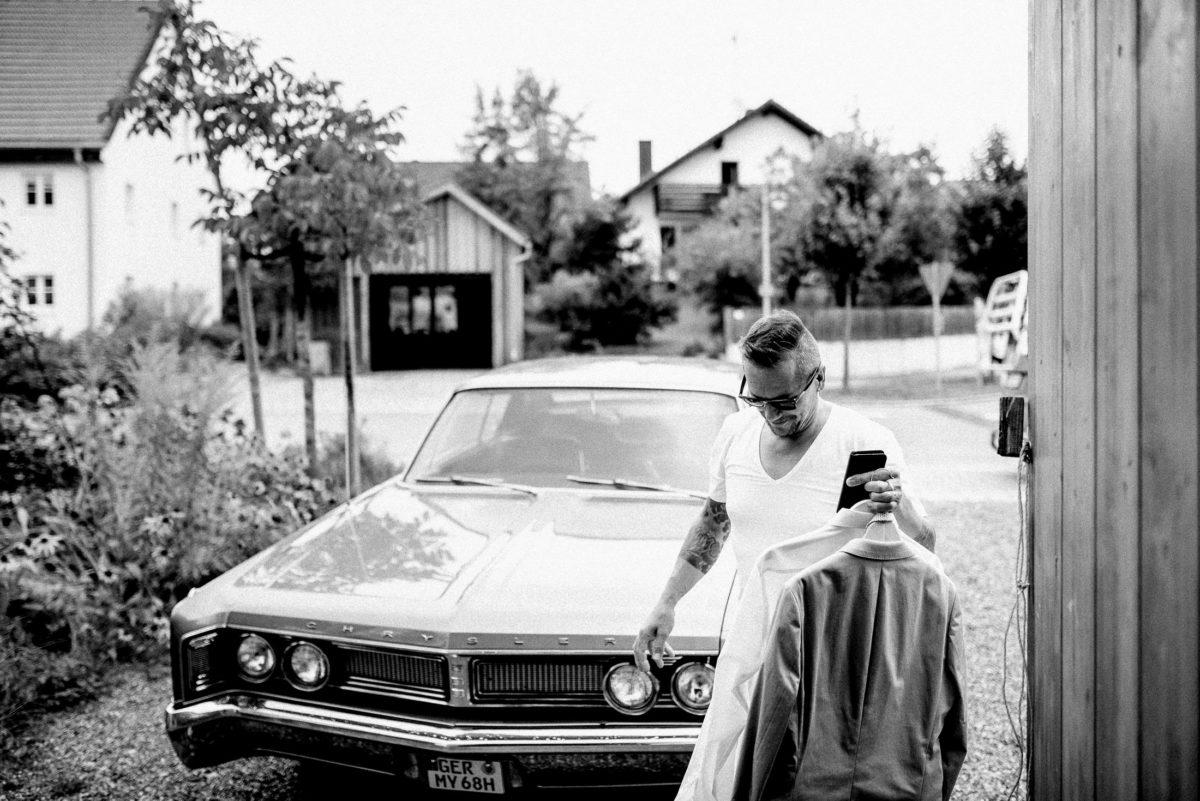 Chevrolet Oldtimer,Anzug,Hemd,Sonnenbrille,Mann